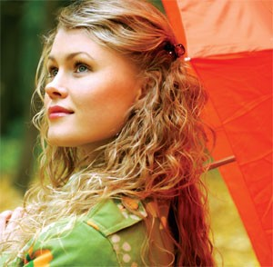 photo of a young woman gazing up towards the sky holding a colorful umbrella - hired power - eating disorder interventions